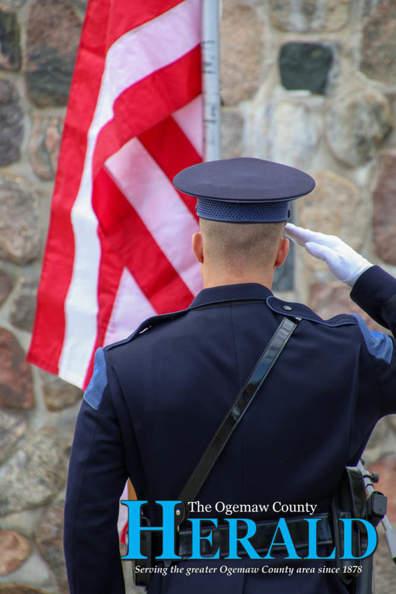 MSP Trooper Gordon Sandula salutes the flag at the end of the ceremony.