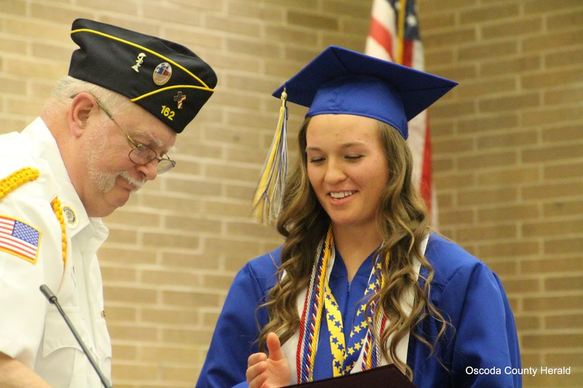 A.J Welser presents Lauren Kuffel with the American Legion Post 162 Bill Summerville Scholarship.