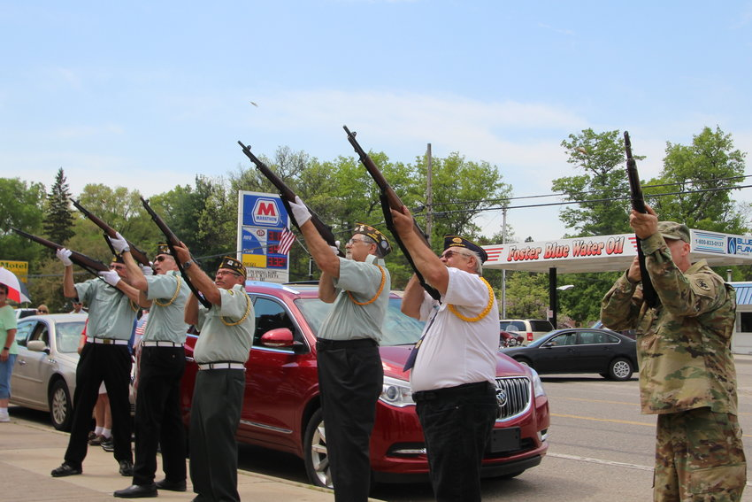 The veterans perform a rifle salute during last year's Memorial Day ceremony in Mio.