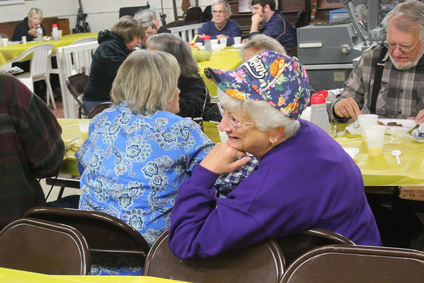 Ruth Leach-Hershberger of Luzerne turns around to talk to someone at the table behind her.