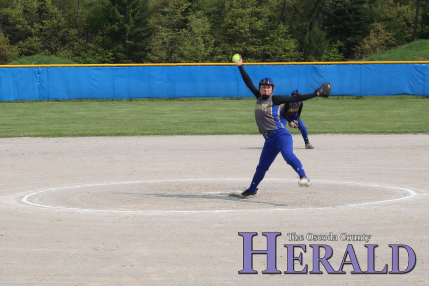 Shelby Yoder fires off a pitch from the mound during the first semi-final game of districts May 31.
