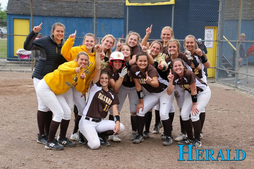 The Ogemaw Heights softball team poses for a photo after winning the district title in Cadillac June 1.