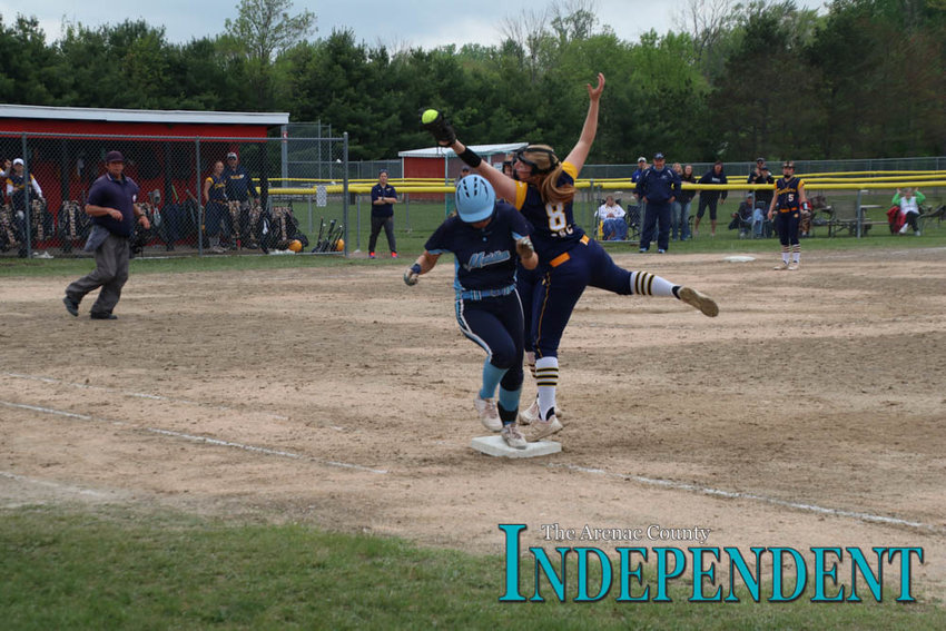 Karleigh McBride reaches for a ball.