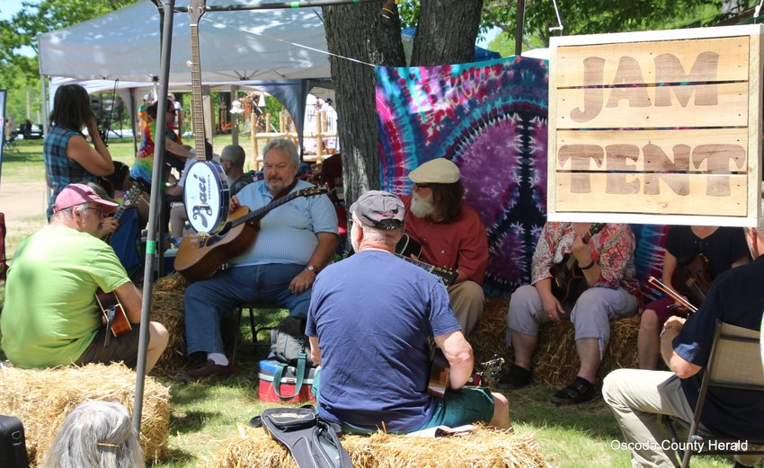 Participants enjoy playing music together in the Jam Tent.