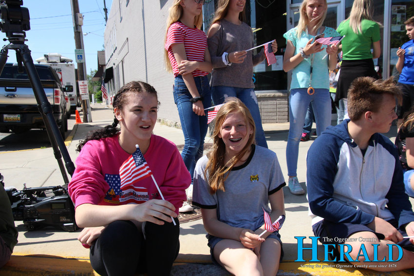 Savahana Miller, 14, and Hannah Daniels, 14, sit and wait for the Back to the Bricks drivers to come by.