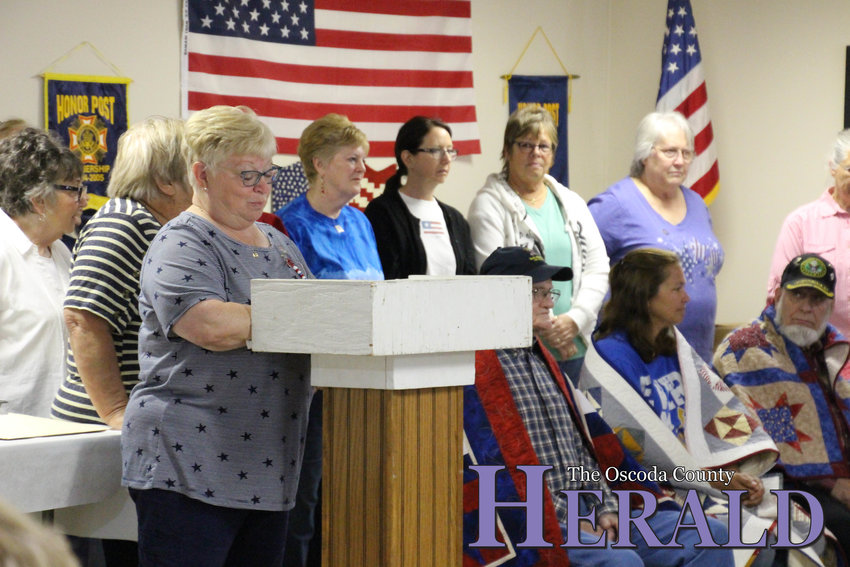 Quilts of Valor member Barbara Jacobs presents the veterans with their quilts during the ceremony Friday, June 14.