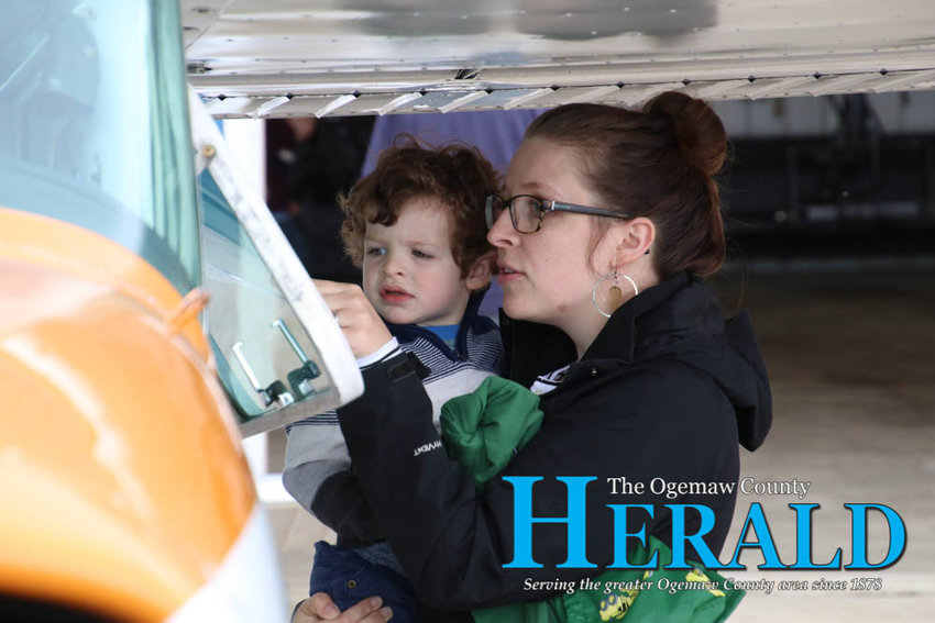 Erin and Soren Resteiner check out one of the airplanes at the annual fly-in event.