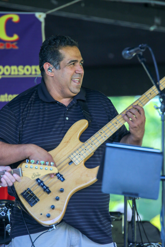 Joe Cardenas of The Showdown Band jams on the bass guitar during a Music in the Park performance last year.