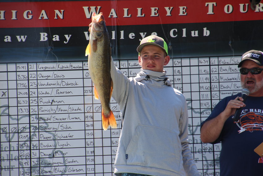 Brayden Ruckman, 14 shows the audience his heaviest walleye.