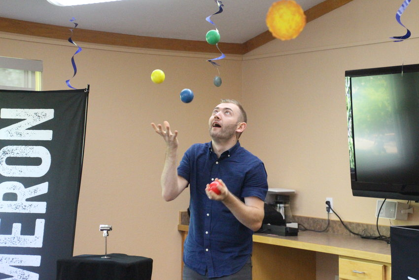 Cameron Zvara warms up the audience with some juggling before he gets to the magic.
