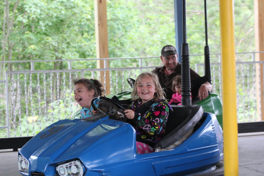 Jaina, 5, and Jaylee Bunker, 8, of Holland laugh as they share a bumper car.