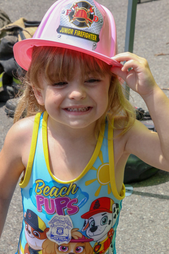 Keithabelle Bigelow, 4, poses for a photo in her new firefighter helmet.