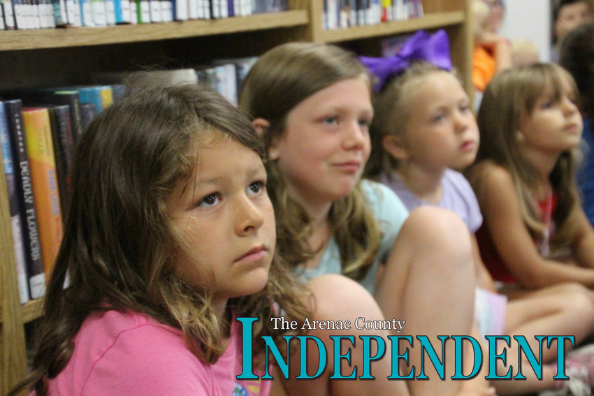 Kaili Manary, 6, Khloe Berthiaume, 10, Enslee Davis, 5, and Makenzie Mclaren, 5, all of Standish, pay attention during the presentation.