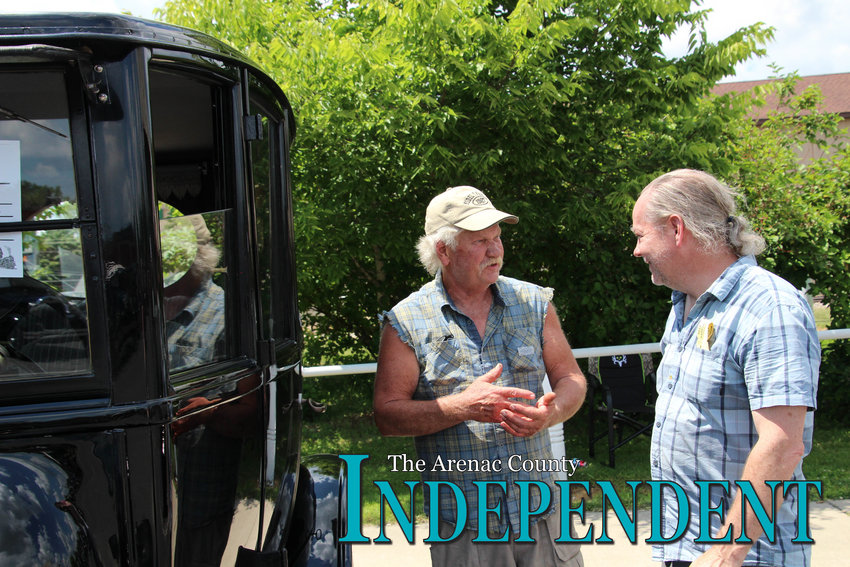 Don Booth of Bay City and Mark Finley of Rochester talk near a 1922 Ford.