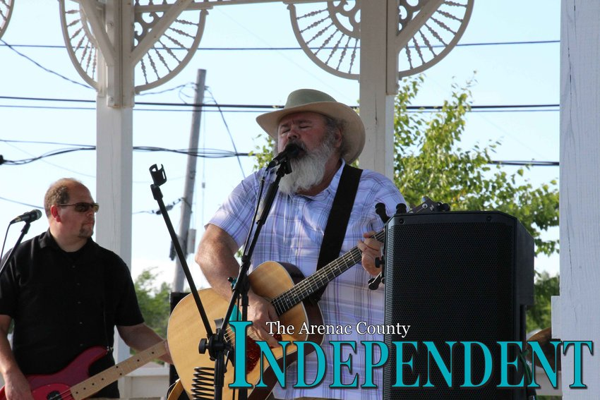 Brian Spicer performs for the crowd at the Standish Historical Depot as part of the area's 2019 summer concert series Thursday, July 18.
