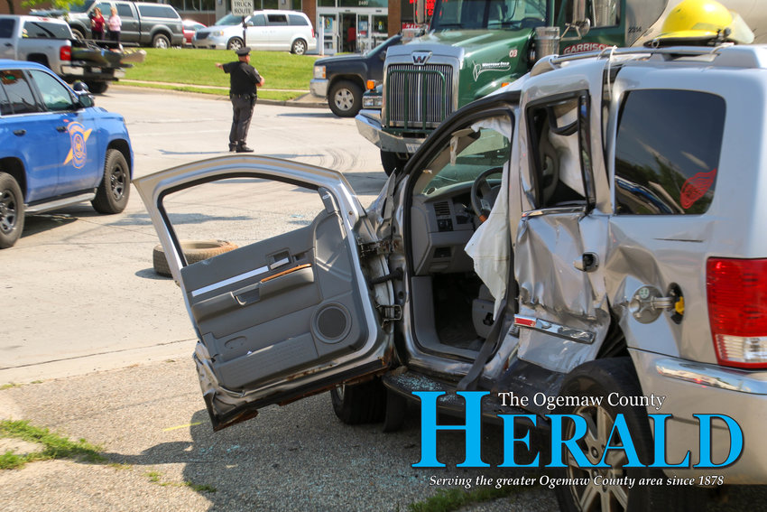 The driver's side of a Dodge Aspen was badly damaged after a semi collided with it.