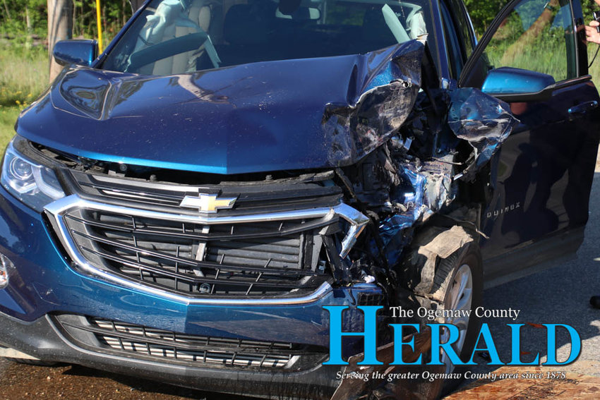The front end of a 2019 Chevrolet Equinox is badly damaged after it collided with the rear end of a pickup July 31.