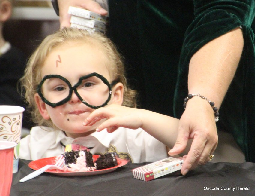 Danny Quick enjoys some cake while in full Harry Potter regalia.