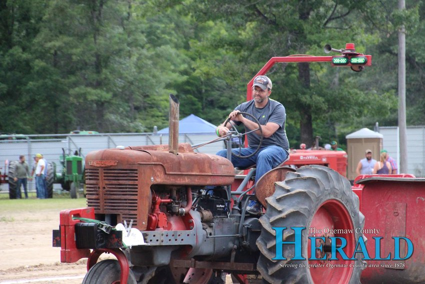 William Smith competes in the tractor pull.