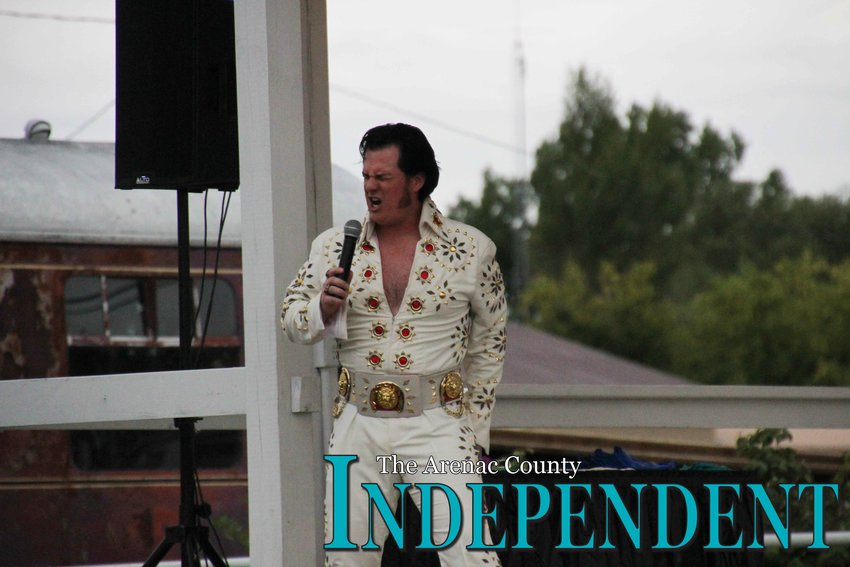 The Elvis Presley impersonator rocks out for the crowd at the Standish depot Thursday, Aug. 15.