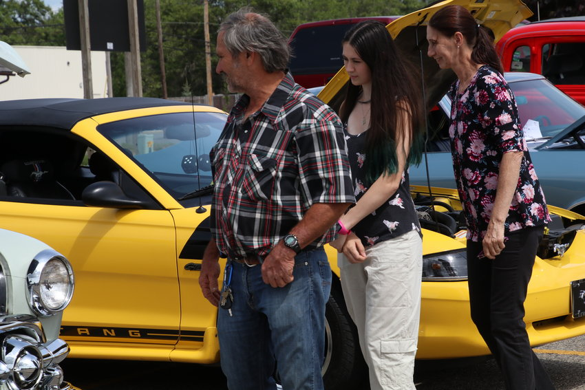 Joe, Jamie and Julie Mayhew of Alabama and Lupton peruse the cars.