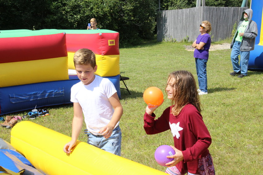 Noah Gratopp and Hannah Dishaw participate in a game available during the Unified in Christ concert event a couple years ago.
