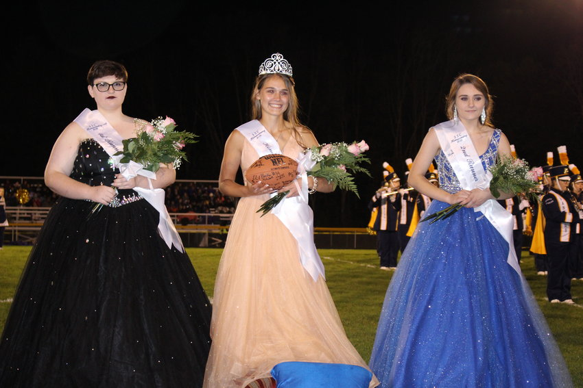 SSC Homecoming first runner-up Elli Gehlman (L) and second runner-up Madison DeWyse pose with Homecoming Queen Laiken Ex.