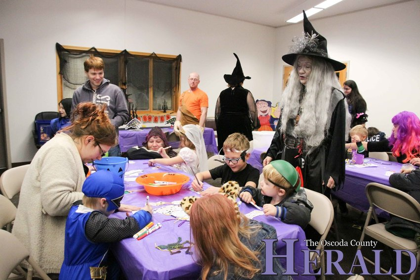 Families enjoy the Fall Family Fun Fest at the library in Mio last year.