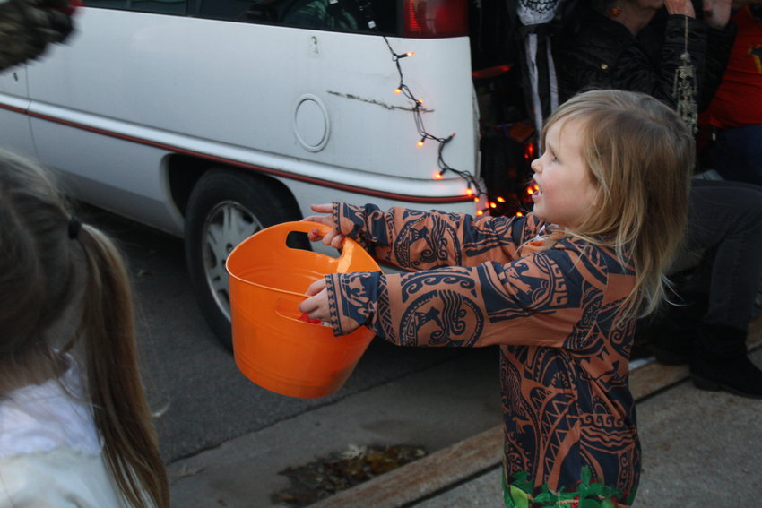 Hailey Willett, 4 at the time, dressed as Maui, holds out her bucket during last year's trunk or treat in Rose City.