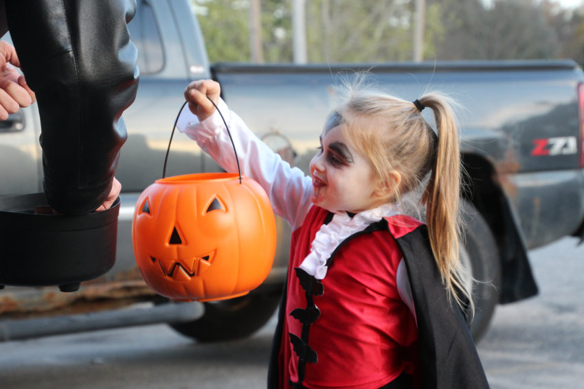 Sadie Handrich asks for candy at the Oscoda County Herald office on Halloween night last year.
