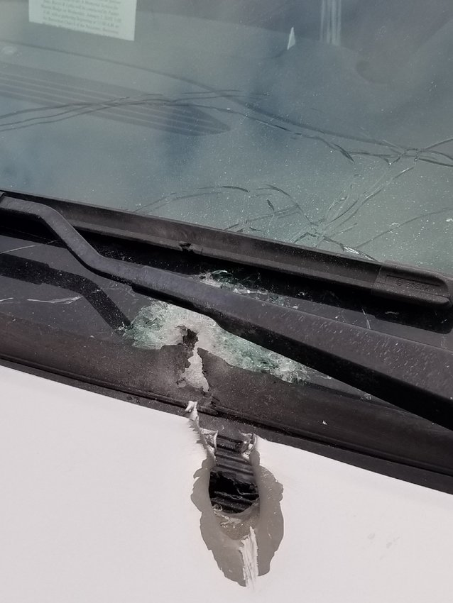 A photo of the bullet hole under the driver's side windshield wiper.