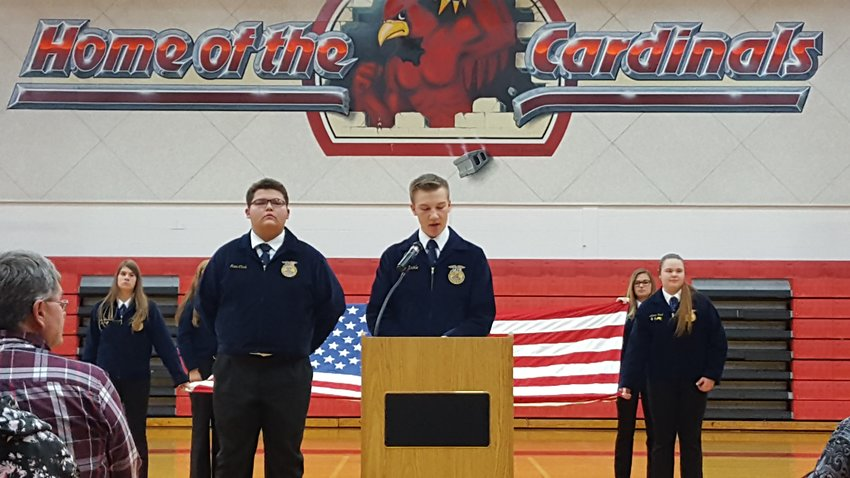FFA members complete a flag folding with a speech explaining the meaning of each fold of the flag.