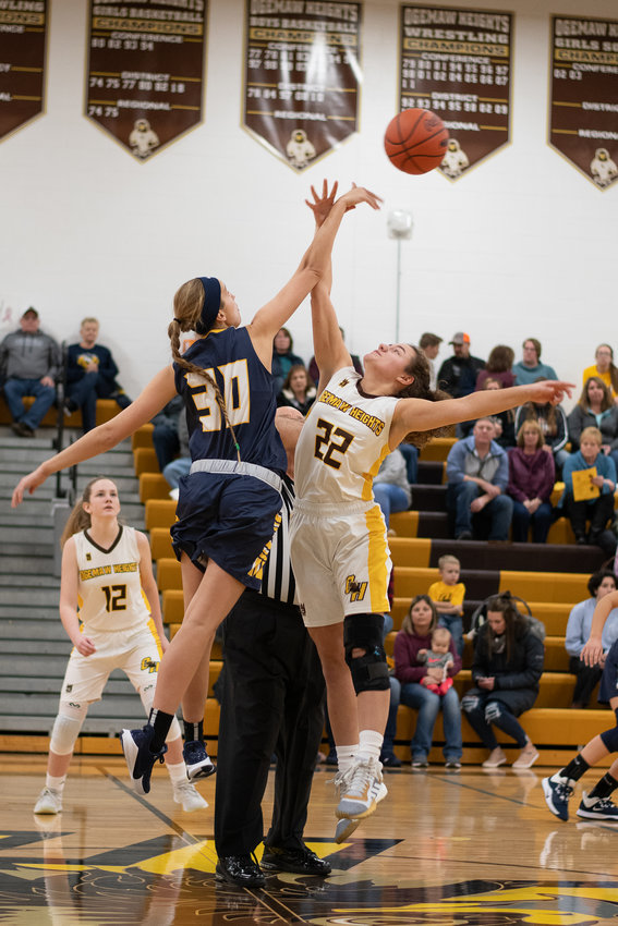Macey Fegan (30) and Rowan Peace (22) battle for the jump ball to start the contest.
