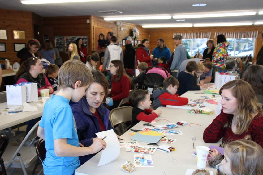 Families gather for crafts before meeting Santa.