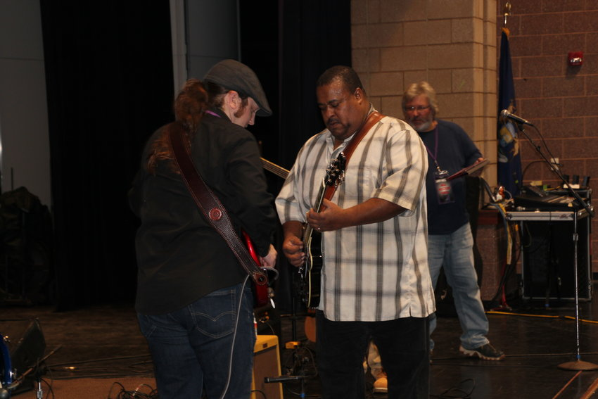 Former SSC student Rhett Yocom has a quick jam session with Larry McCray before the concert.
