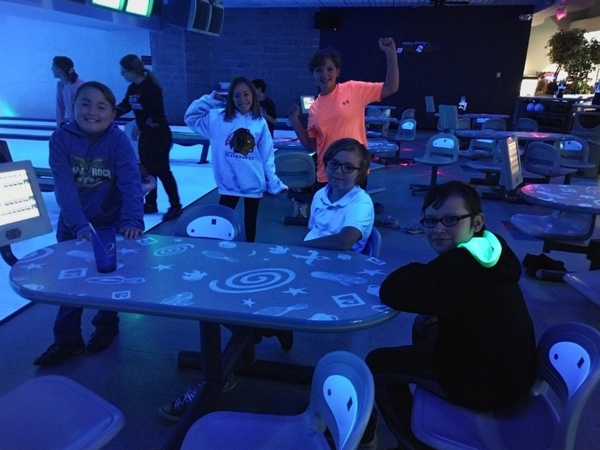Team Reveur winners, Oliver McKean, Leatta McKean, Kylie Trombly, Mason Strawn (seated), and Jacob Boensch (seated) enjoy their reward of an afternoon of pizza, soda, and bowling.