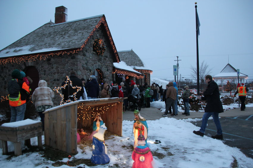 People line up outside the depot waiting to see Santa.