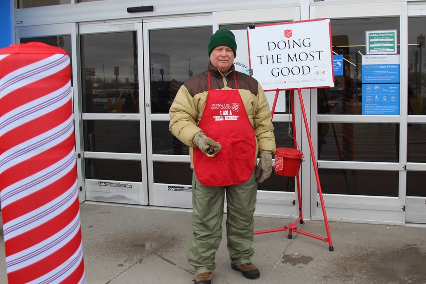 Phill Losee, member and past president of the West Branch Optimist Club, volunteers for the Salvation Army bell-ringing campaign