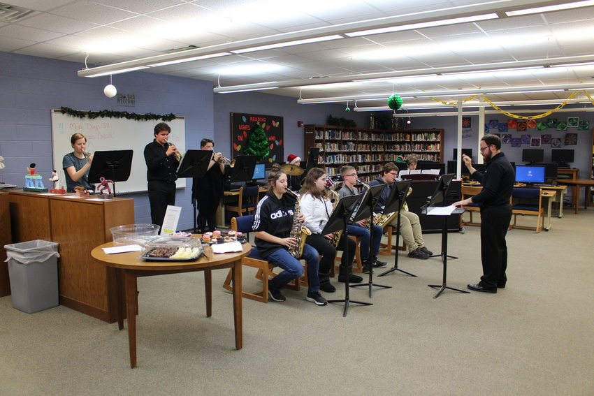 """The Ogemaw Heights Jazz Band plays a medley of songs from 'A Charlie Brown Christmas"""" during the Dec. 16 board of education meeting"""