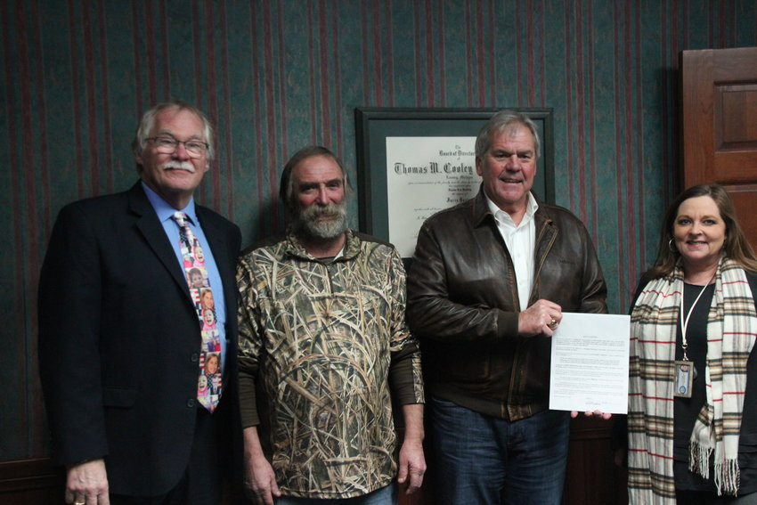 Duane L. Hadley, Jeff Trombley, Rick Fiddler, and Lisa Salgat with the deed to the donated land.