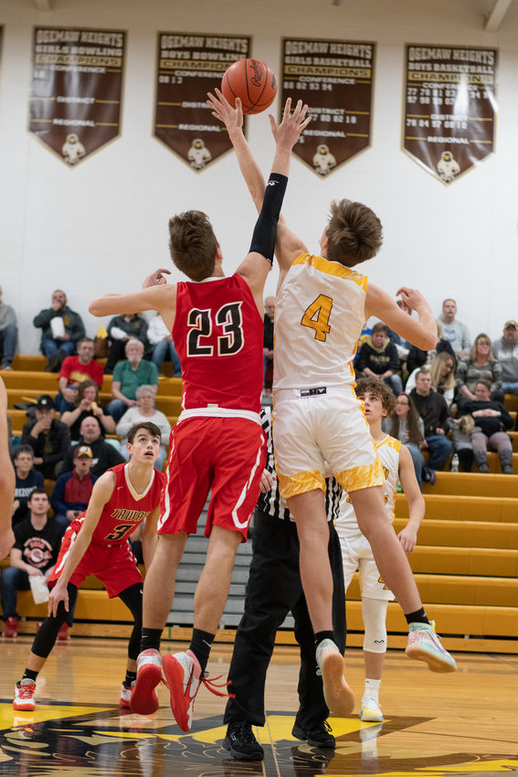 Jacob Rhine beats Noah Davis (23) to the tip to kick off the contest between the Falcons and the Braves.