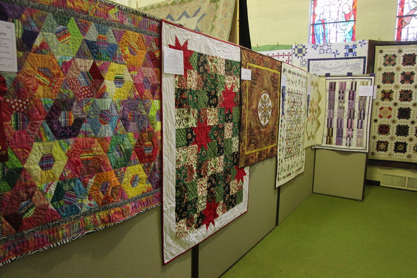 Quilts hung up on display at the Northeast Art Center.