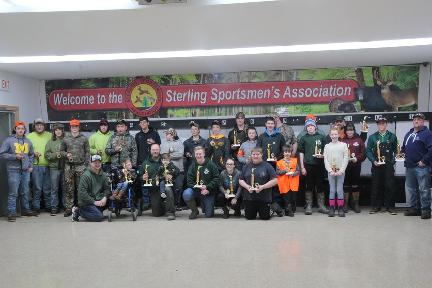 A group photo of all the winners in the sixth annual squirrel and rabbit hunt.