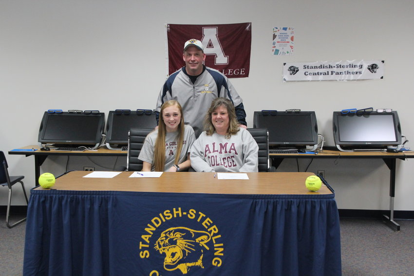 Laiken Fryzel signed to play softball at Alma College with her mother Tina Fryzel and coach Rich Sullivan by her side.