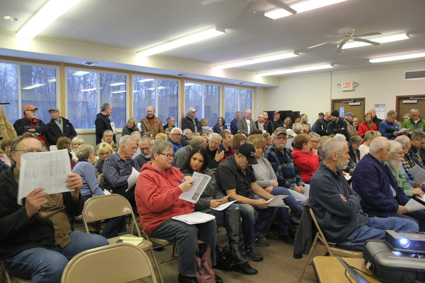 Concerned shoreline property owners gathered to voice concerns and gather information on available resources at the Whitney Township Hall.