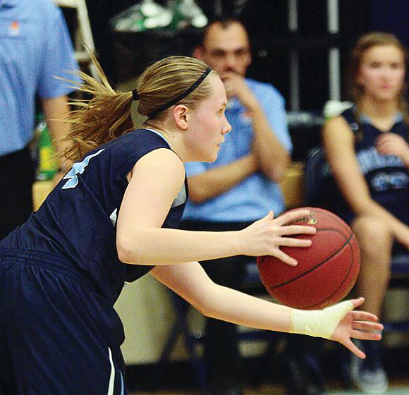Grizzlies' senior captain Alli Sandberg drives toward the basket during a recent game.