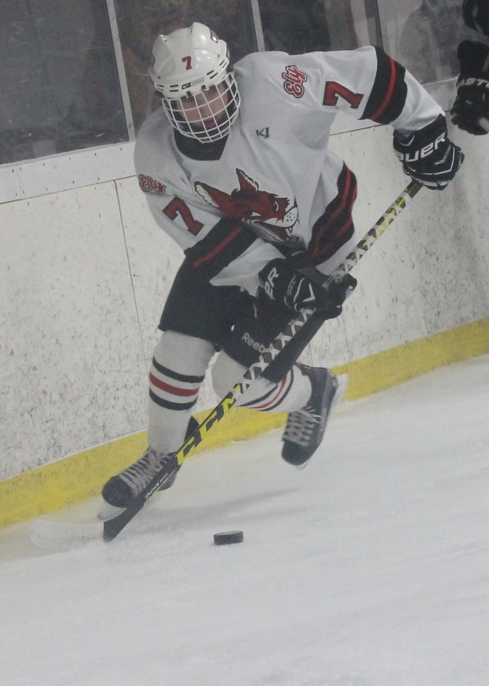 Ely forward Thomas Montana carries the puck into the North Shore zone on Monday.