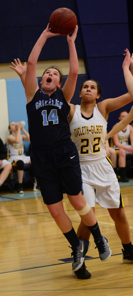 North Woods sophomore Kate Stone goes up strong with the ball   versus Eveleth-Gilbert.