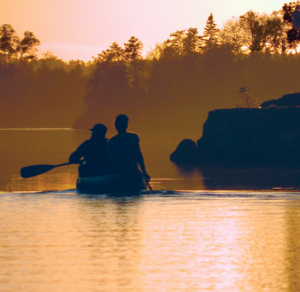Canoeists paddle against the sunset along the Kawishiwi watershed in the Boundary Waters Canoe Area Wilderness. The proposed Twin Metals mine would be located just upstream of the 1.1 million-acre wilderness.