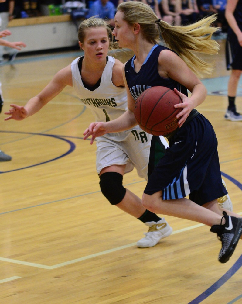 North Woods sophomore Hanna Sandberg tries to turn the corner as Northeast Range's Shayler Lislegard (1) defends in the Grizzlies' 67-35 home win in Monday's Section 7A tournament opener.